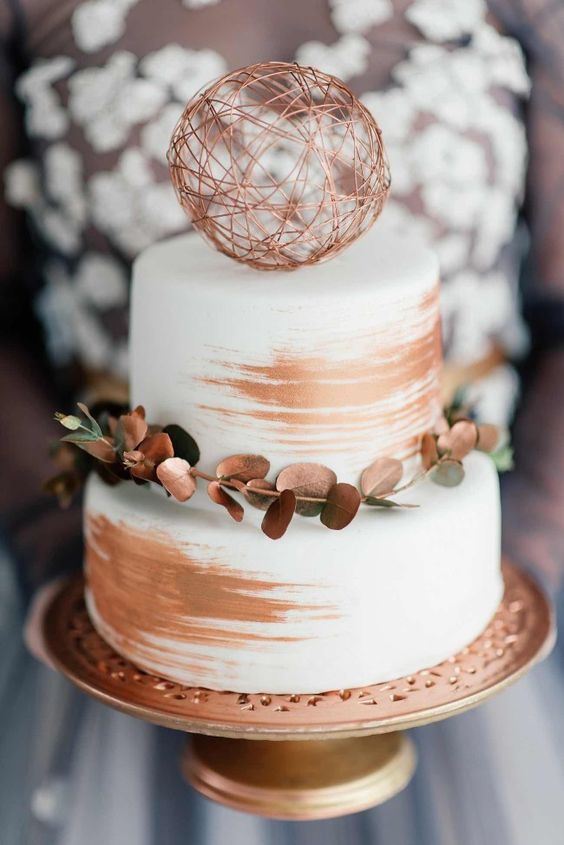 41-simple-chic-white-cake-with-a-modern-make-over-brushed-with-copper-strokes-and-adorned-with-copper-sprayed-eucalyptus.jpg