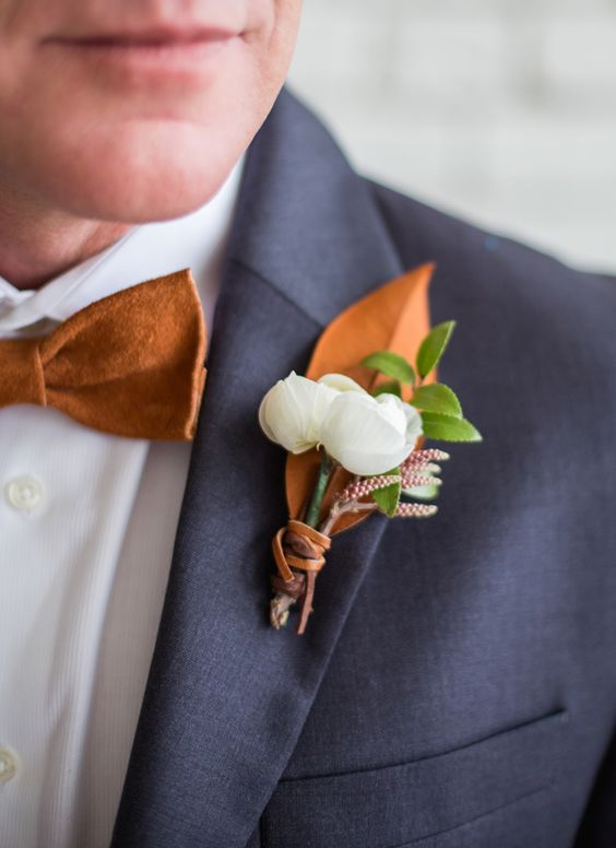 18-dark-grey-suit-a-copper-bow-tie-and-a-copper-and-white-boutonniere.jpg