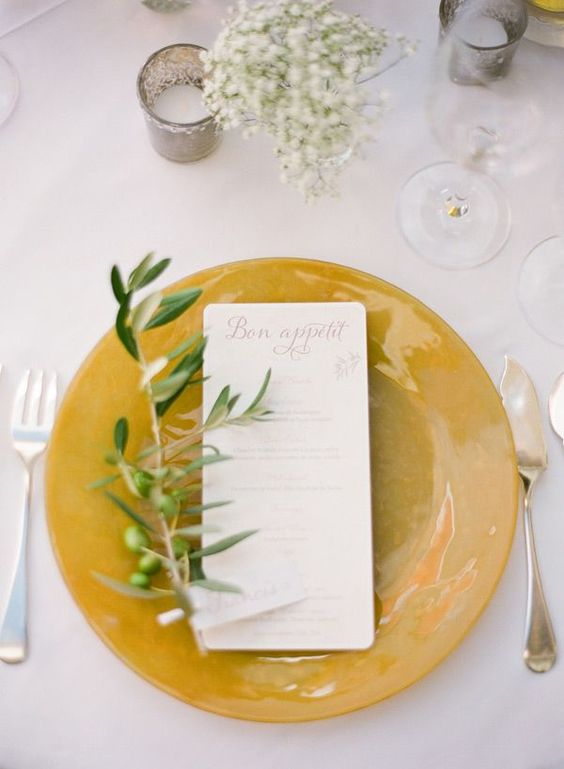 21-a-mustard-charger-with-an-olive-branch-and-babys-breath-for-a-fall-tablescape.jpg