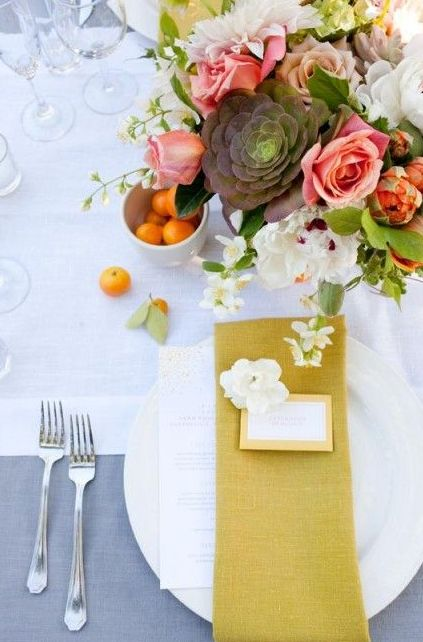 23-a-neutral-tablescape-with-a-bold-floral-centerpiece-and-a-mustard-napkin.jpg