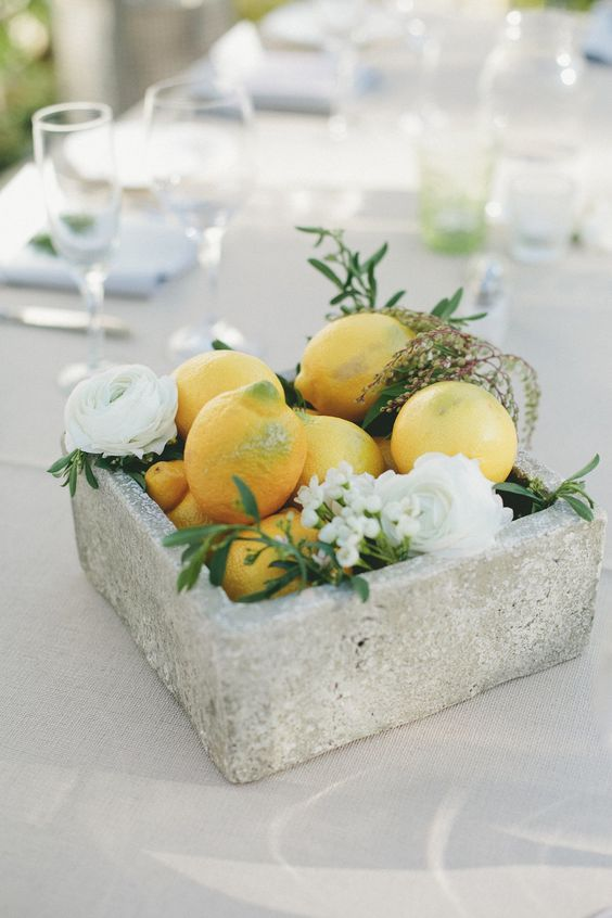 02-a-concrete-bowl-with-fruit-and-flowers-for-a-bold-statement.jpg