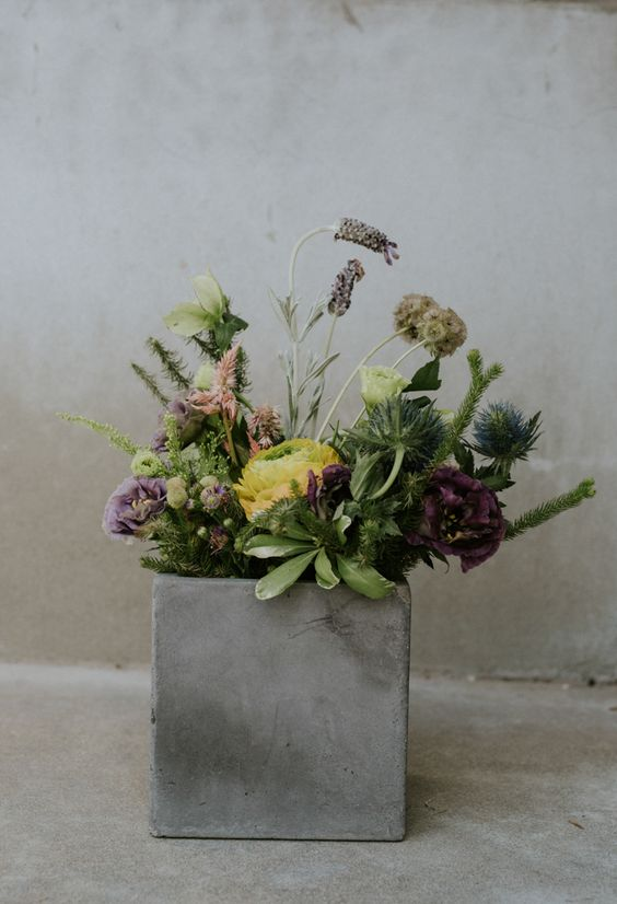 02-a-concrete-box-with-greenery-and-blooms-for-a-modern-wedding-centerpiece.jpg