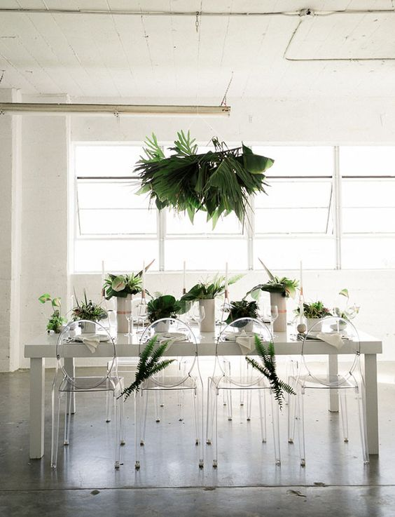 28-a-concrete-table-acrylic-chairs-ad-lush-greenery-for-a-minimalist-wedding.jpg