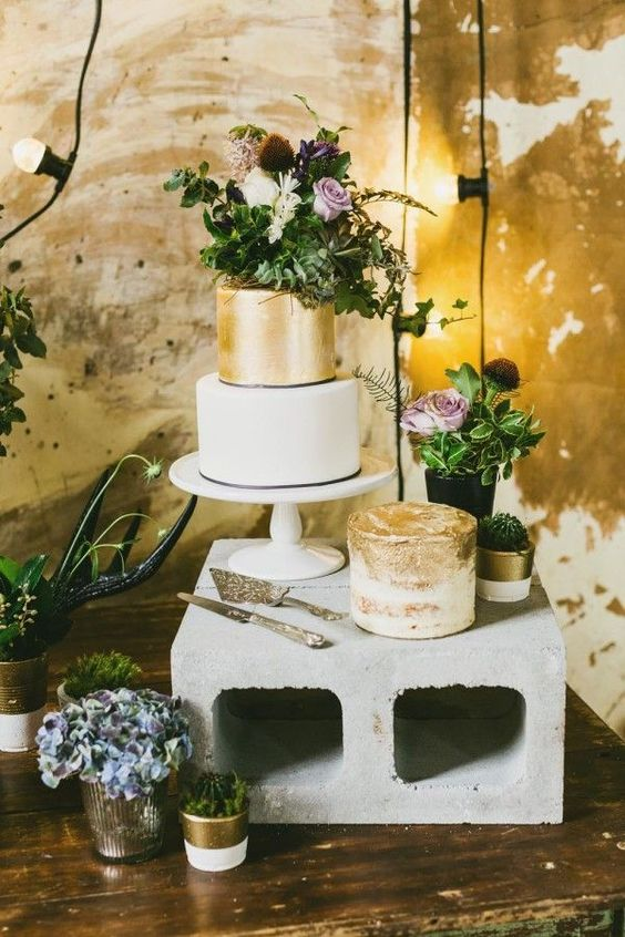 21-simple-concrete-cake-stand-creates-a-perfect-contrast-with-refined-gold-cakes.jpg