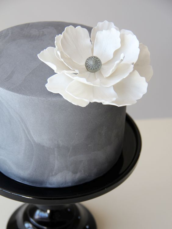 35-textural-concrete-wedding-cake-with-a-large-white-flower.jpg