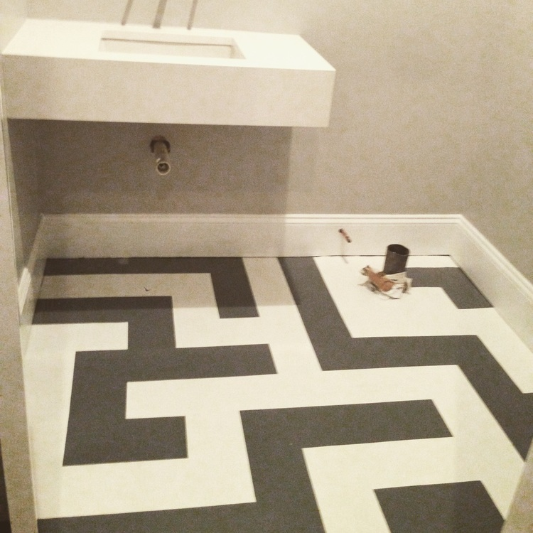 Concrete floor painted, custom stone sink in Quartz masters white, basement bathroom design, grey and white floor, geometric pattern painted floor
