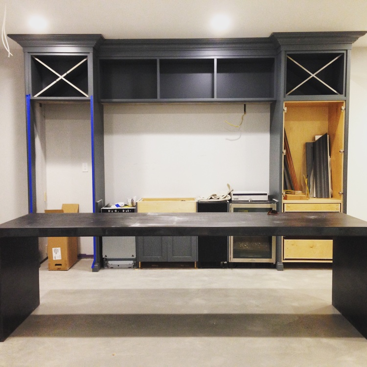 Blackened steel, BM grey cabinetry, concrete floors