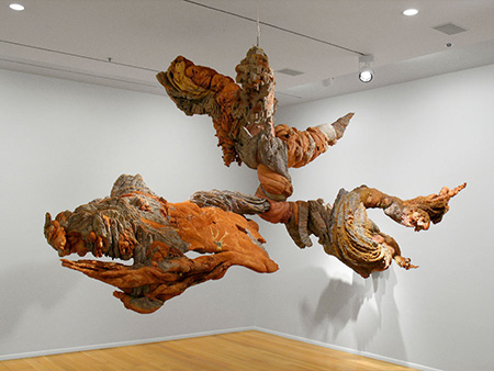 Shades of brick red and brown swirl together in this hanging organic sculpture.
