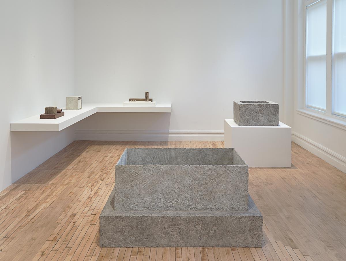 Gallery's installment of Richard Fleischner's geometric sculptures.