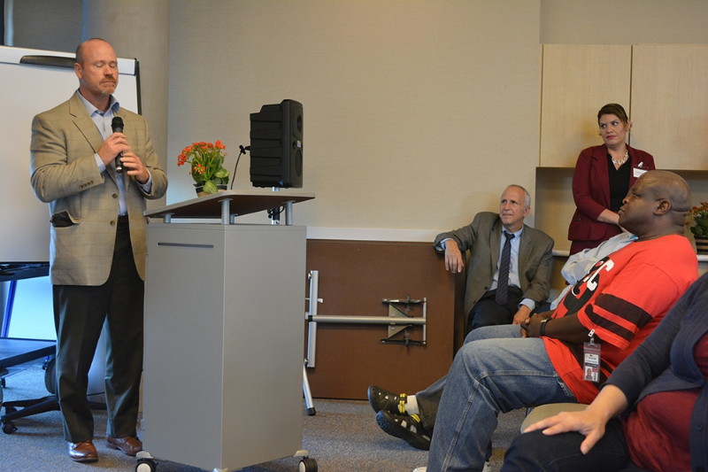 Kevin Jones , left, spoke briefly to accept a Housing Heroes award from San Mateo County on Oct. 22, while county health and recovery director Stephen Kaplan and Telecare housing coordinator Lee Cates (seated) and PSC II Yesenia Cortes (standing) listen. Cates was recognized as a Housing Hero in 2013.