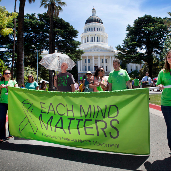 MENTAL HEALTH MATTERS DAY PARTICIPANTS RALLY OUTSIDE THE CAPITOL BUILDING IN SACRAMENTO. PHOTO: EACHMINDMATTERS.ORG