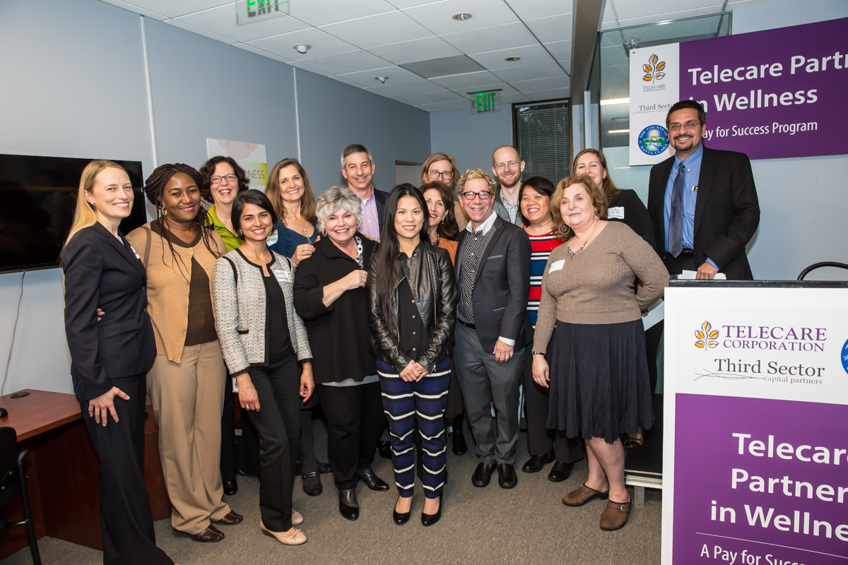 (L-R)  Greta Hansen , Chief Assistant County Counsel for Santa Clara County;  Margaret Obilor , Director of Adult Services for Santa Clara County;  Faith Richie , Senior Vice President of Development at Telecare;  Kavita Naratan , Deputy County Counsel for Santa Clara County;  Shannon Mong , Director of Innovation Initiatives at Telecare;  Toni Tullys , Director of Behavioral Health Services for Santa Clara County;  Geoff Richman , Director of Budgets at Telecare;  Michelle Ho , Mental Health Program Specialist for Santa Clara County;  Anne Bakar , President and CEO of Telecare;  Shelagh Little , Director of Business Development at Telecare;  Scott Madover , Director of SUDS at Telecare;  John Ginther , Manager at Third Sector Capital Partners Inc.;  Dr. Tiffany Ho , Medical Director for Santa Clara County;  Carol Silverman , Telecare Director of Evaluation;  Caroline Whistler , President and Co-Founder of Third Sector Capital Partners, Inc.; and  Miguel Marquez , Chief Operating Officer for Santa Clara County, at the Telecare Partners in Wellness Open House on February 8, 2017.