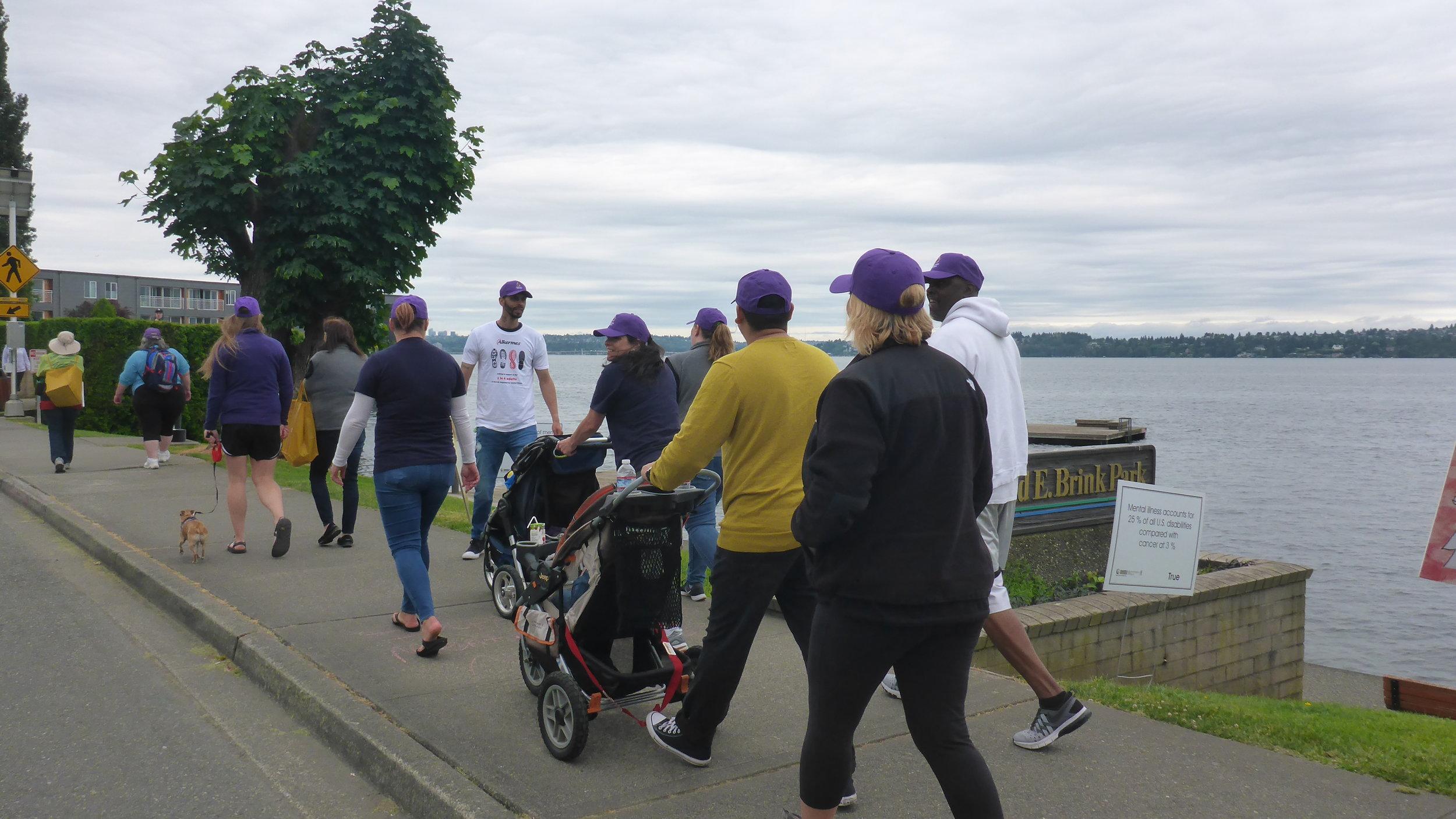 13 Purple hats walking.JPG