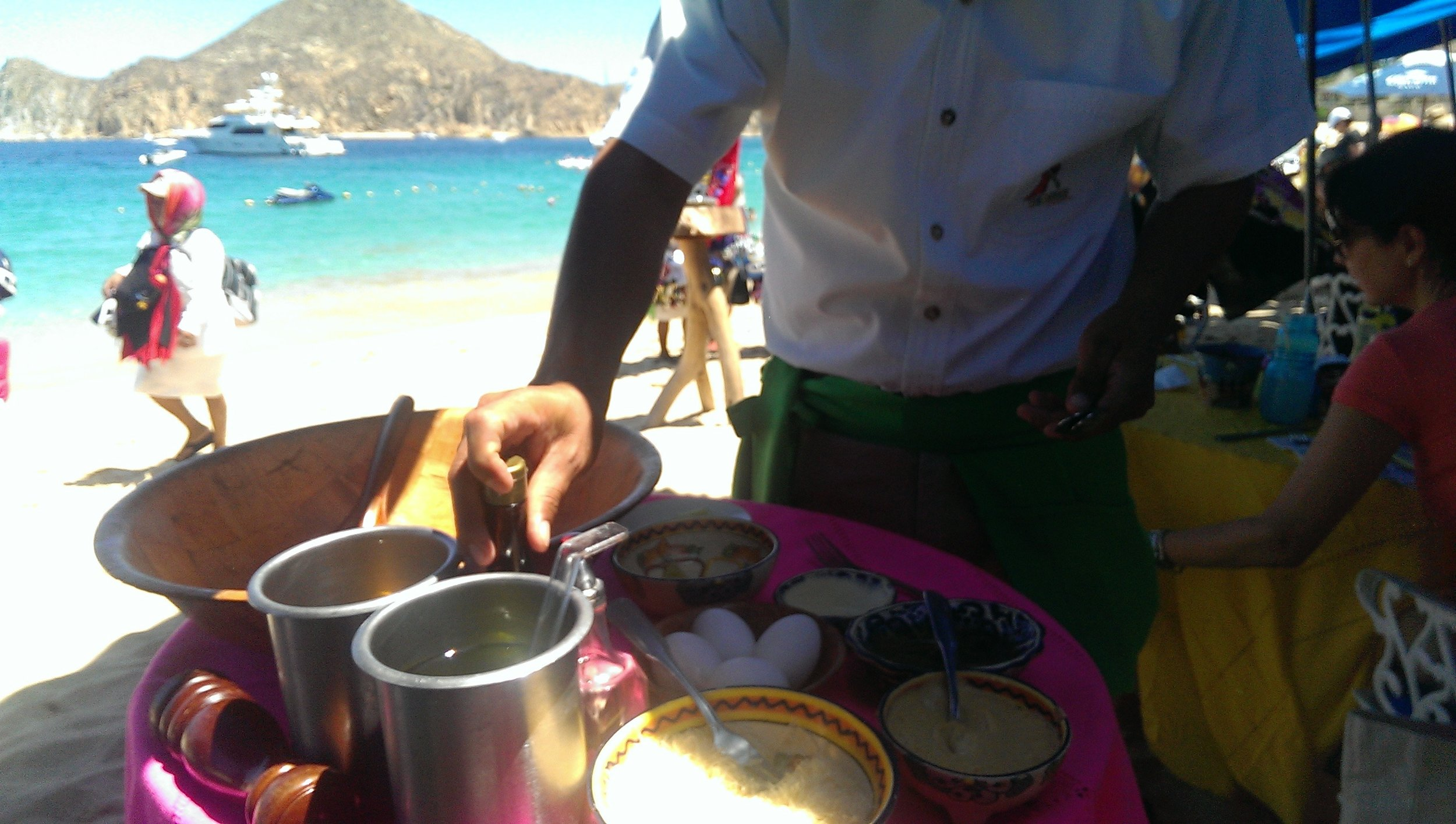 Caesar Salads made table side at The Office in Cabo San Lucas, Mexico