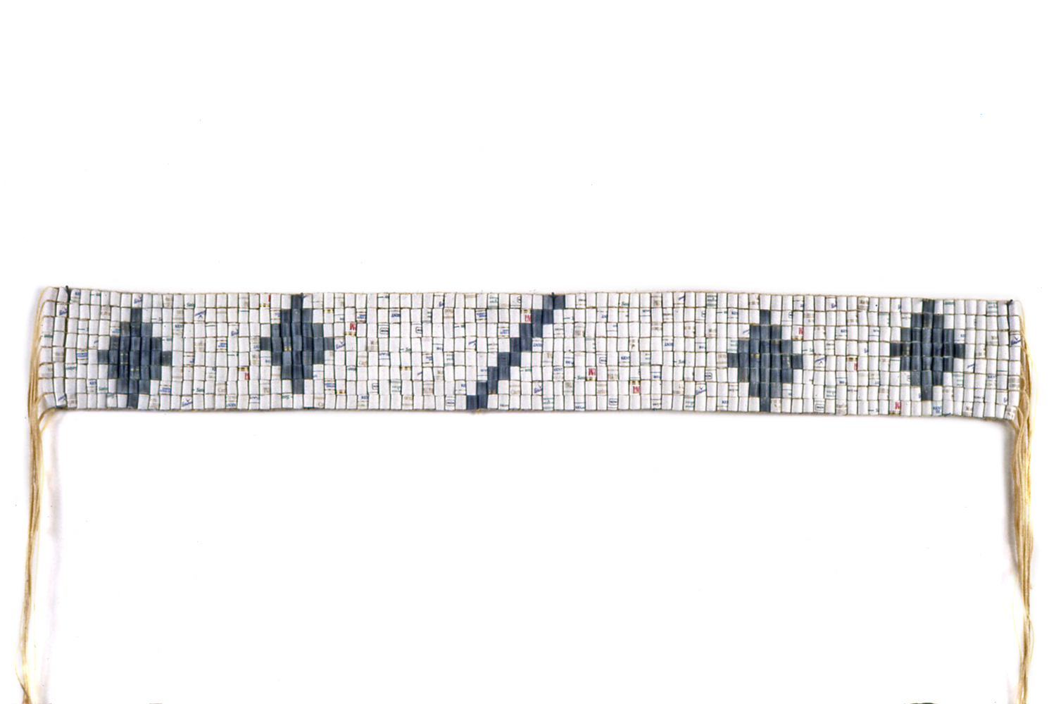 CONDOLENCE BELT  With    cigarette filters substituted for shell beads, this hand-woven belt is patterned after an     Iroquois wampum belt that was used to express condolence.