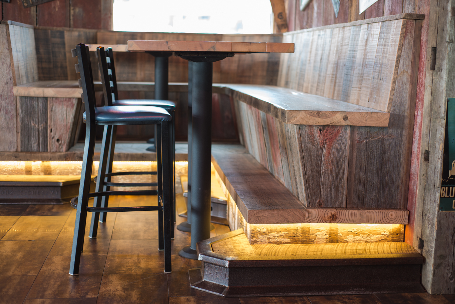 A variety of authentically weathered barn wood planks anchor the vintage design of Harpoon Willie's dining booths.