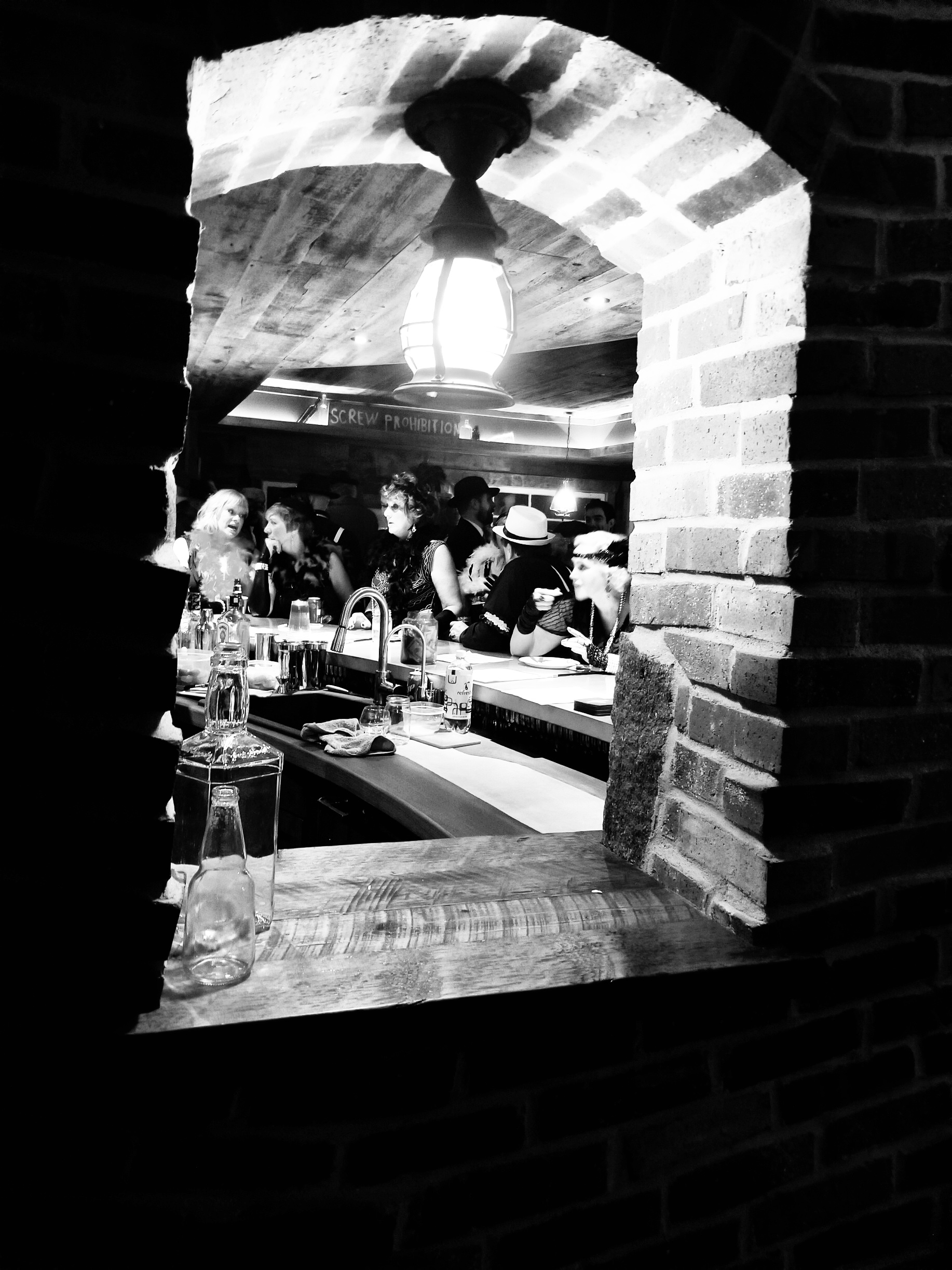 Looking through that same brick window on party night.