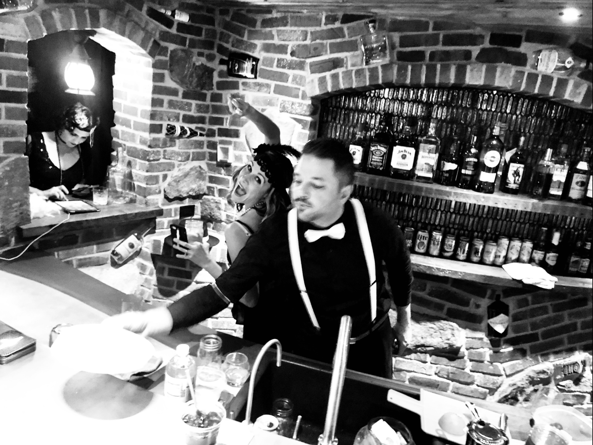 Shenanigans behind the bar. Notice the bottles embedded in the brick.