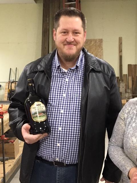 Jeremy looking slightly dwarfed by that big bottle.