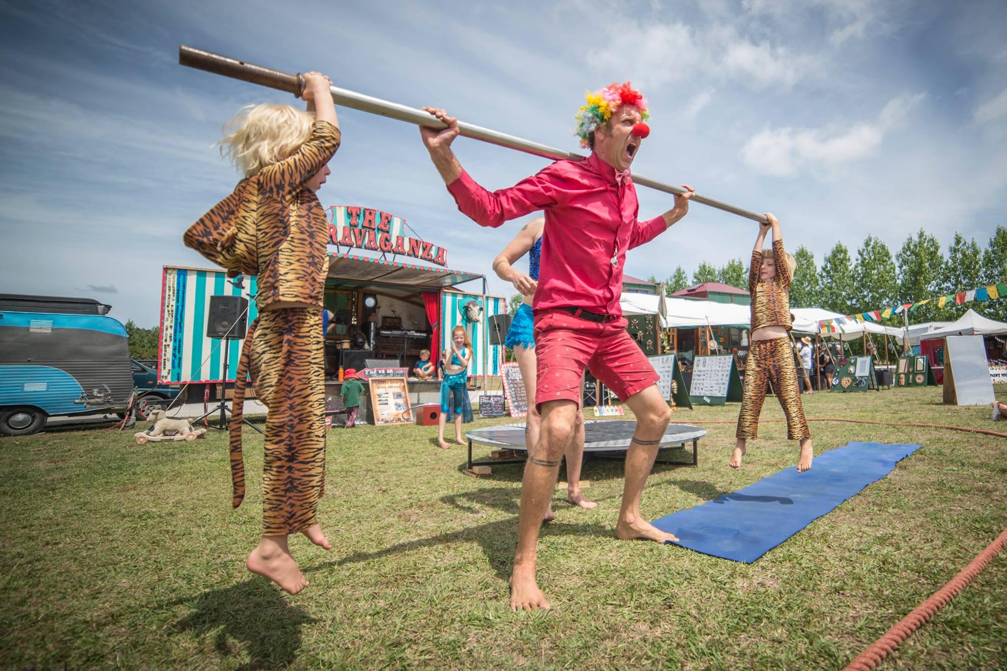ashton clown lifting tigers.jpg