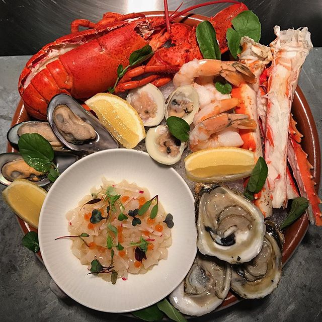 Merry Christmas with a little Fruits de Mer! Lobster, king crab, oysters, clams, mussels + scallop crudo #greysalt #getgrey #merrychristmas #happyholidays