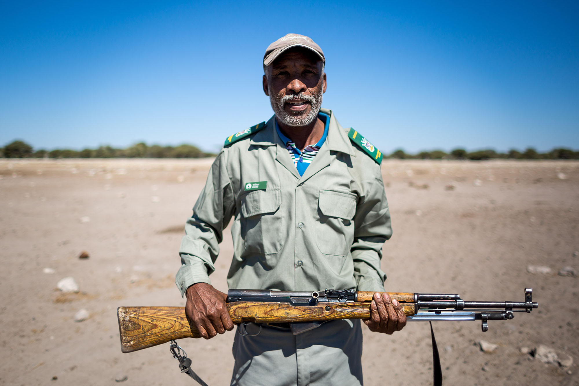 MET game guard, Willem Kubeb protects the young scientists from Etosha's potentially dangerous animals.