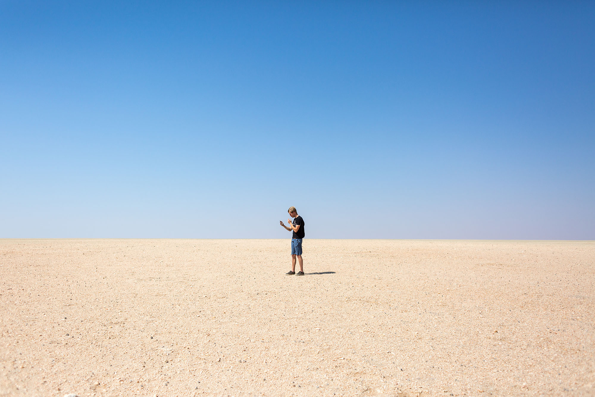 Jasper Vannueville of Vives University College, Belgium attempts to locate a plant with GPS on the desolate gravel plains of the Namib.