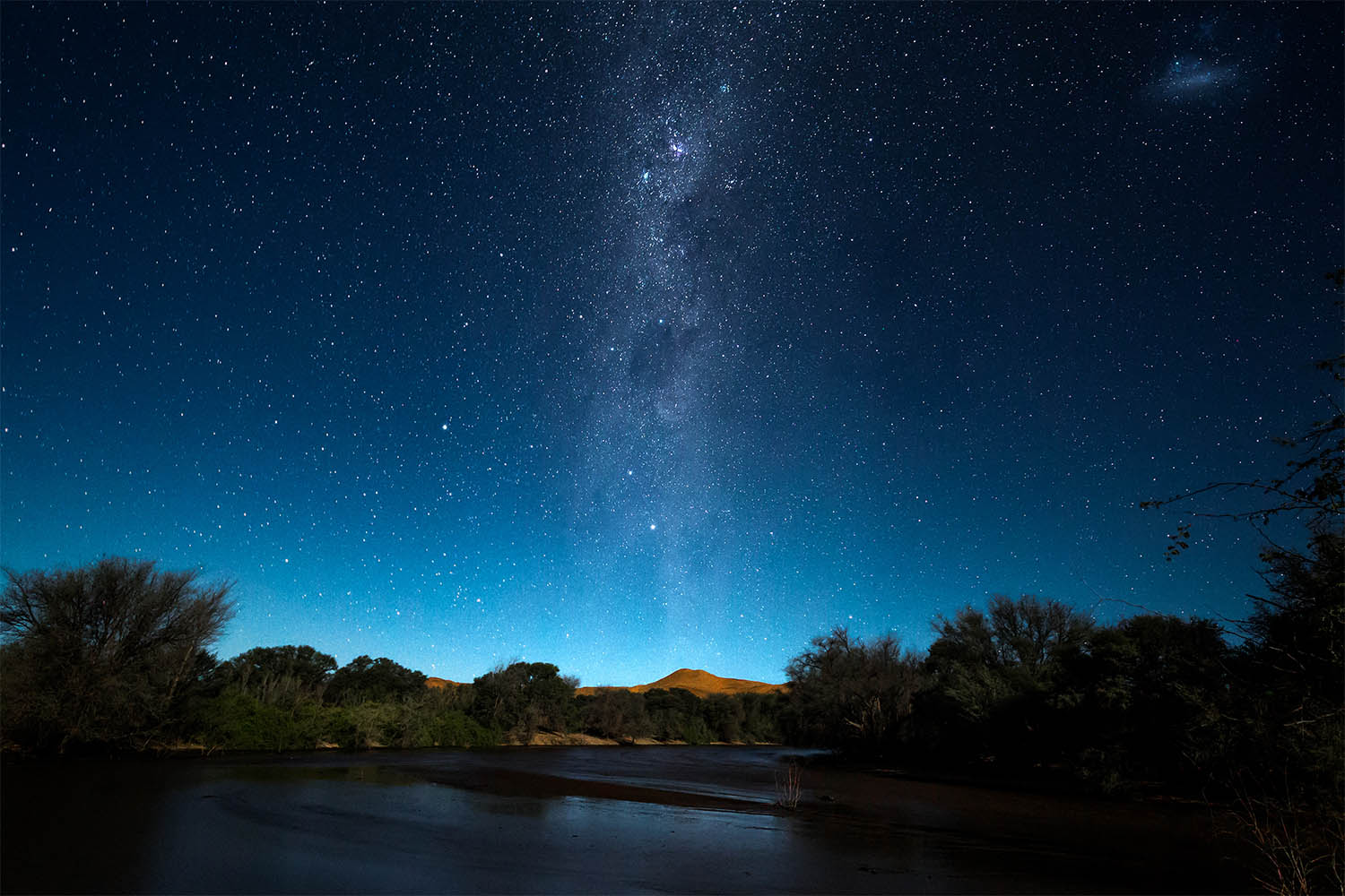 The Kuiseb River flows at night in the central Namib Desert