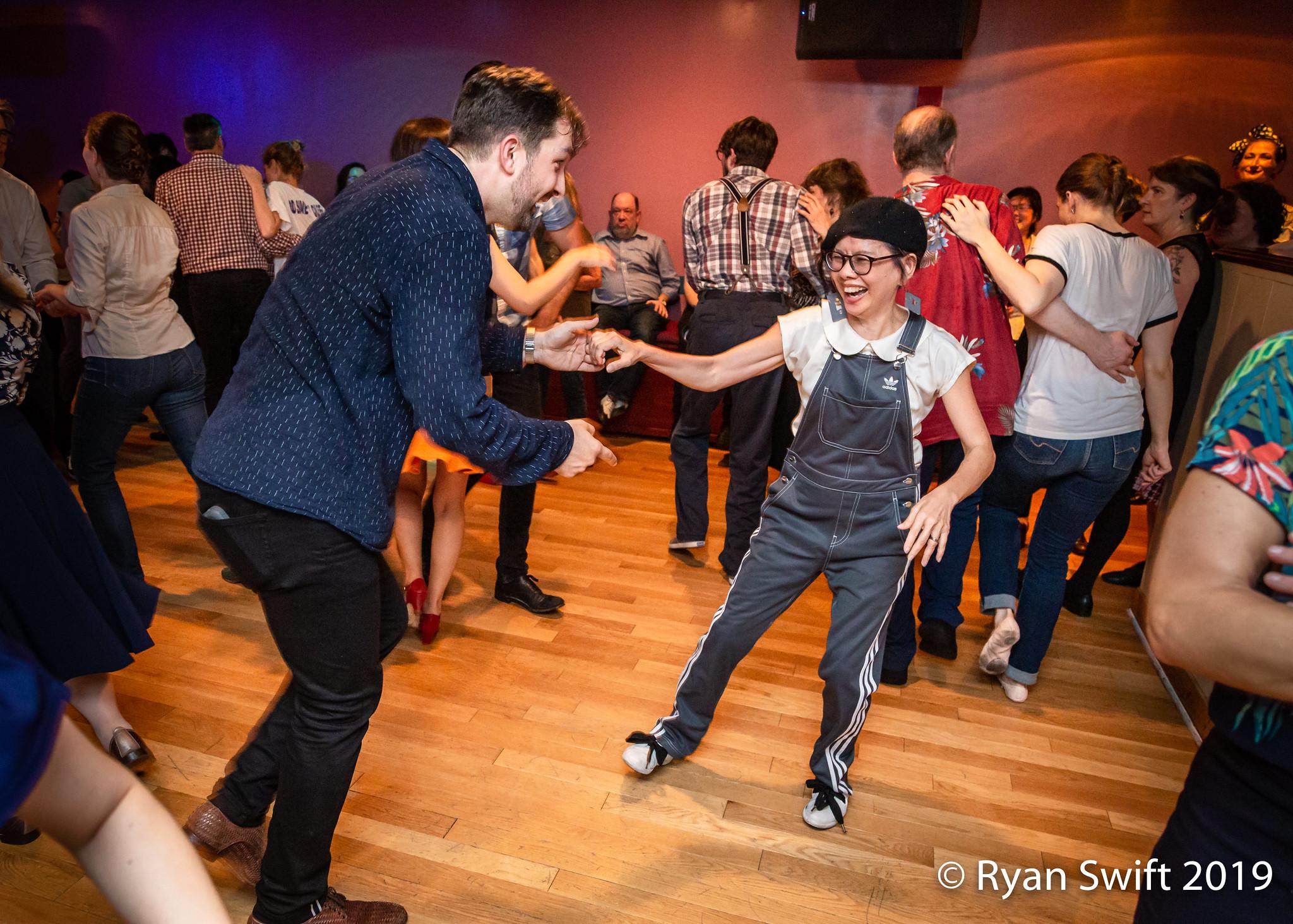 Sing Lim  dances with Adam Brozowski at  Frim Fram Jam  in NYC