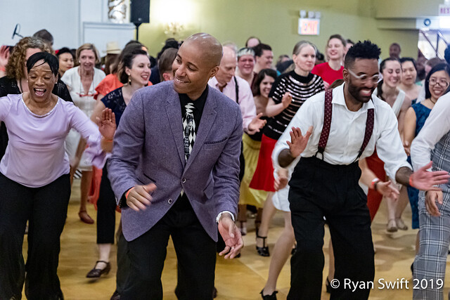 Ryan Francois  leads the Shim Sham at a tribute event for Norma Miller & Frankie Manning hosted by  Ronald Jones and Julia Loving of  SwingwithusNYC