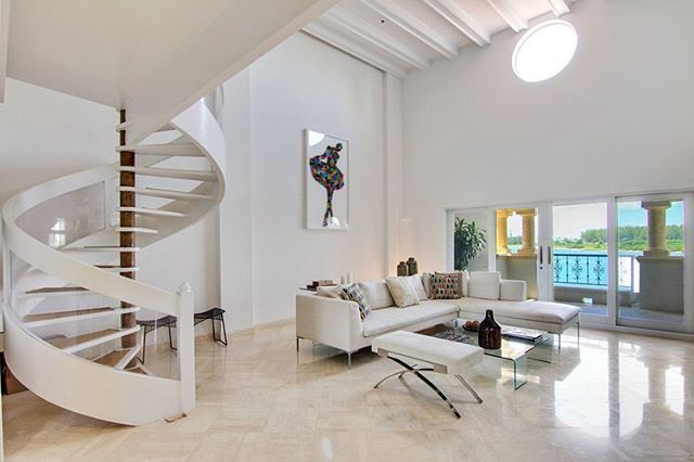 A rare two story townhouse on Fisher Island featuring 3 bedrooms and 3 full bathrooms with one half-bath over 3,164 SF is a unique, exclusive place to call home. There are only two of these layouts on fisher island with high double-floor ceilings and expansive bay and city views. It has a chef's kitchen, private elevator, large master-suite, large terrace and spiral staircase. Fisher Island features a private luxury community on an island only accessible by ferry or boat. Amenities include a 9-hole golf club, tennis club, pool and beach club, multiple restaurants, cafe, grocery store, marina and hospital among others. It is currently listed for $3.75 million or for rent at $24,000 per month. #FisherIsland #LuxuryRealEstate #MiamiRealEstate • • • For more information buying, renting or selling real-estate in Miami head to DemetriDemascusMiami.com Call/ Text: 203-252-7201