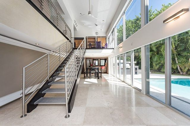 Tranquil, private living in the beautiful #CoralGables. This 5,212 SF home is located at 144 North Prospect Dr. and features 4 bedrooms and 4 bathrooms. It was originally built in 1971 and was designed by Miami architect Hilario Candela before being redesigned in the early 2000's by Victor Vazquez. The home exudes eccentric style with custom furniture throughout including purple chairs and blue paneled kitchen. It also features a recording studio, open living concept that lets light flow through the home, a billiards rooms, a master suite with a 2 level master closet, and an outdoor entertainment area with lush landscaping, Summer Kitchen and pool. Currently listed for $2.99 million. #LuxuryListings #MiamiRealEstate • • • For more information buying, renting or selling real-estate in Miami head to DemetriDemascusMiami.com Call/ Text: 203-252-7201