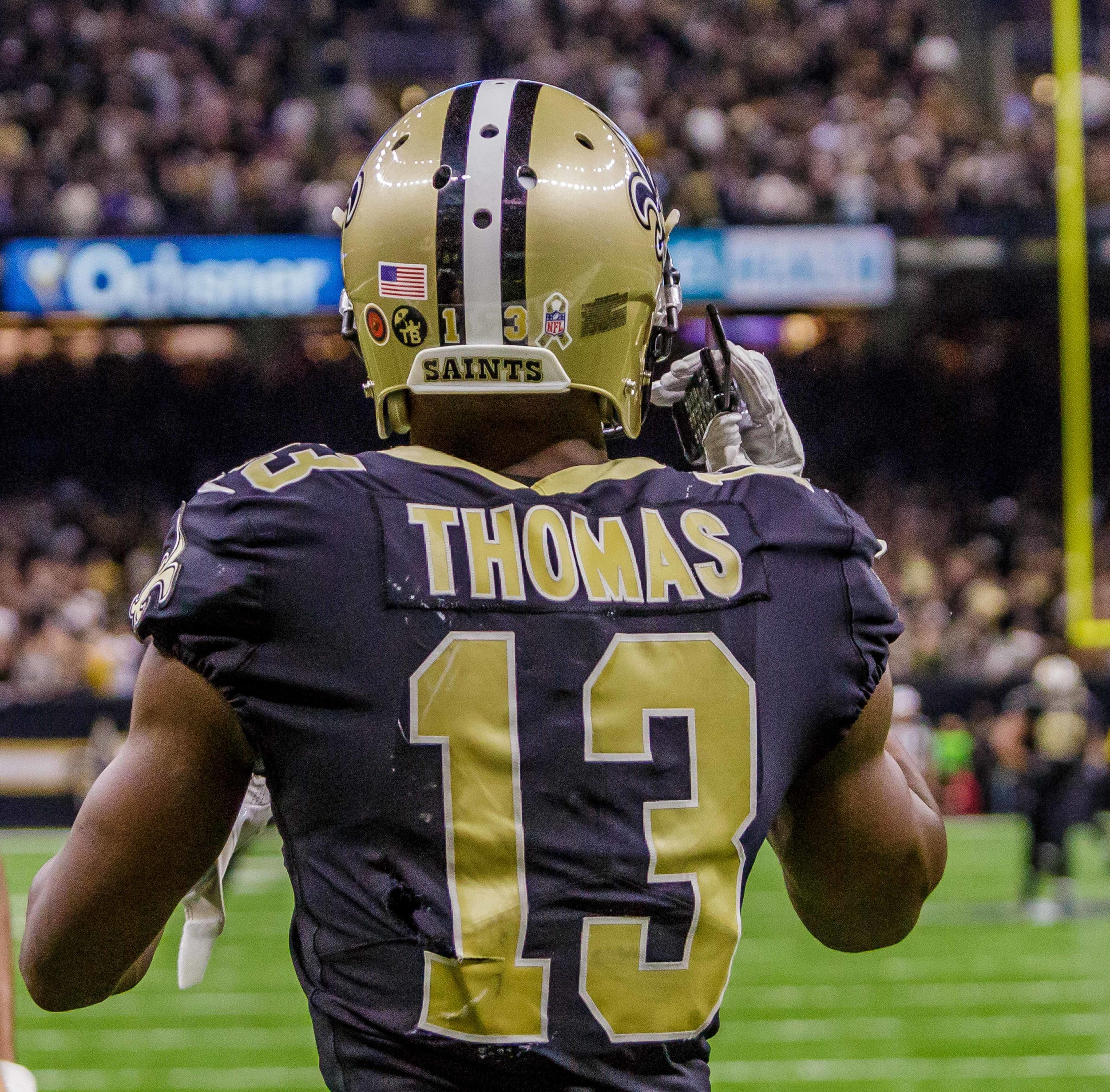 New OrleansSaintswide receiver Michael Thomas (13) pulls out a cell phone that was stashed under the field goal post after scoring a touchdown during the first half of an NFL football game against the Los Angeles Rams in New Orleans, La. Sunday, Nov. 4, 2018. Thomas used the phone to recreate a touchdown celebration performed by formerSaintsplayer Joe Horn in 2003.