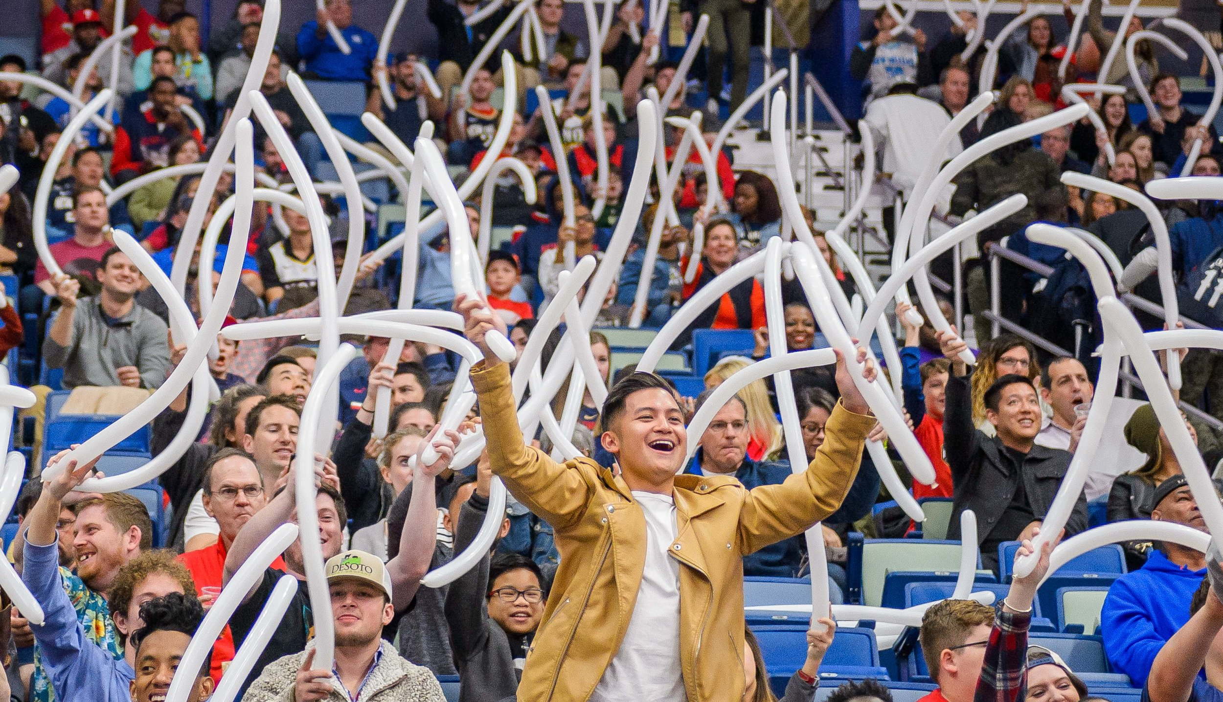 New OrleansPelicans fans wave balloons as they cheer during the first half of an NBA basketball game against the Denver Nuggets in the Smoothie King Center in New Orleans, La. Monday, Nov. 17, 2018. ThePelicanswon, 125-115.