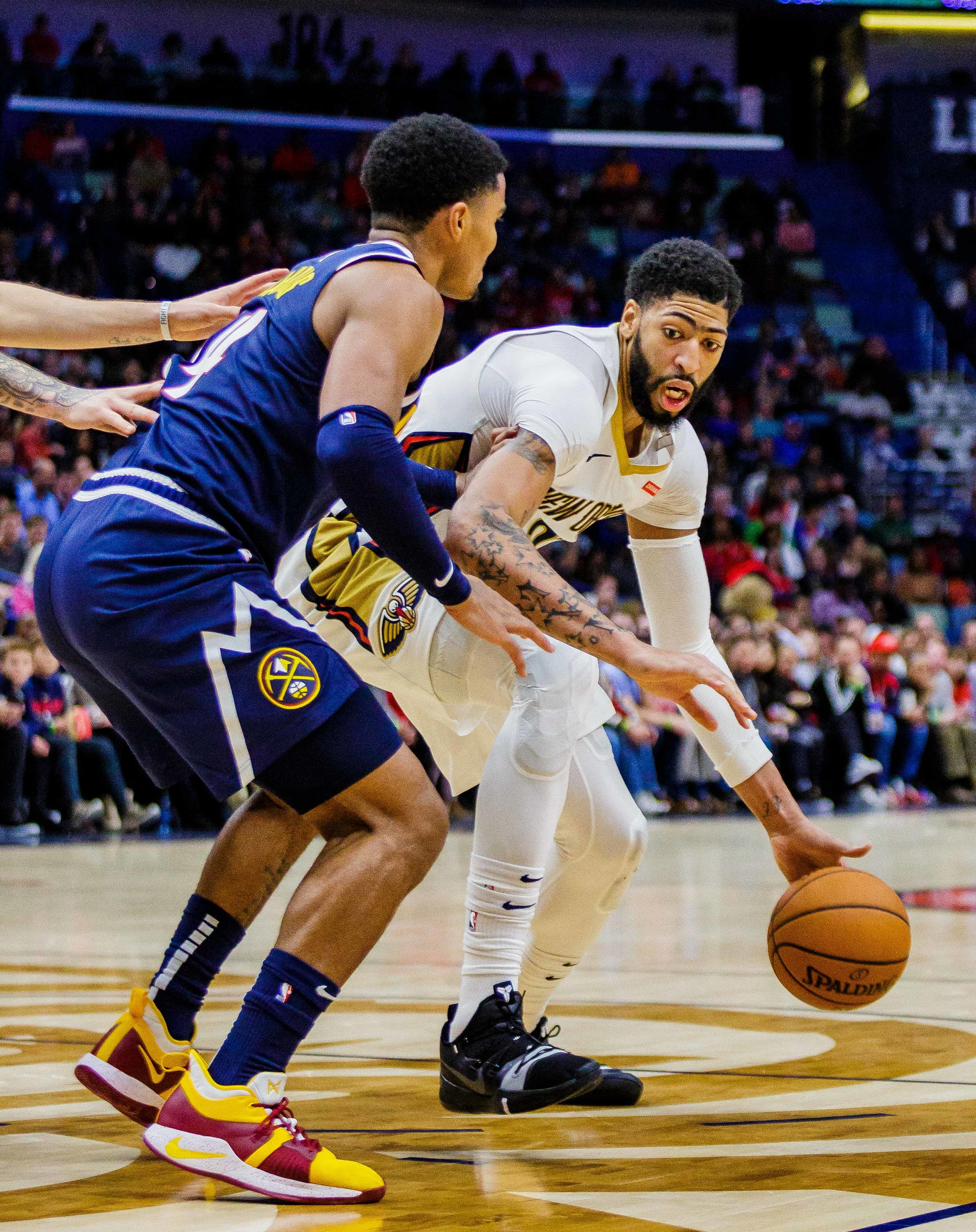 New OrleansPelicansforward Anthony Davis (23) pushes past Denver Nuggets guard Gary Harris (14) in the second half of an NBA basketball game in the Smoothie King Center in New Orleans, La. Monday, Nov. 17, 2018. ThePelicanswon, 125-115.