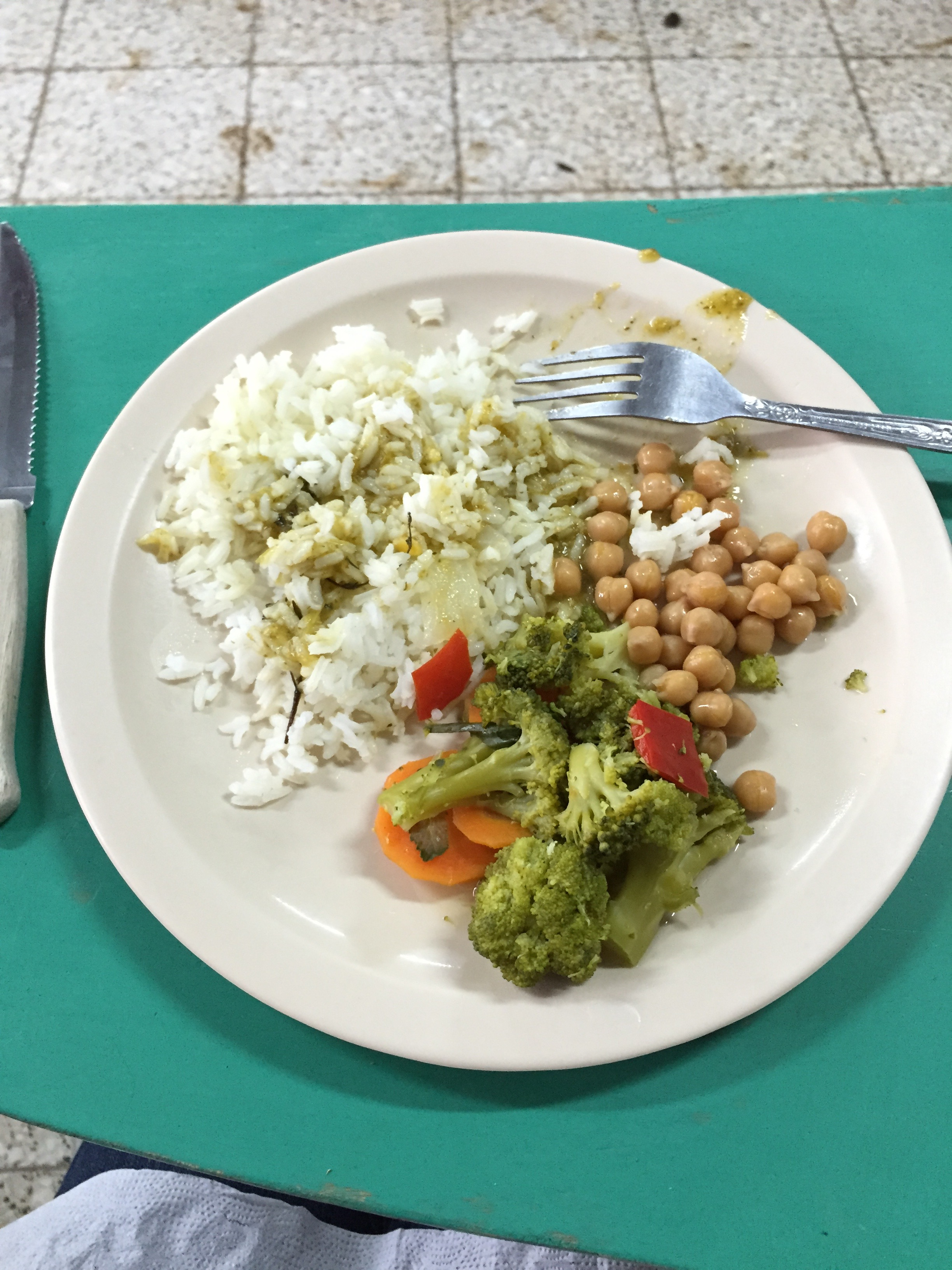 Lunch Cristy brought to the bottle school work site -Chickpeas, rice and veggies with salsa verde