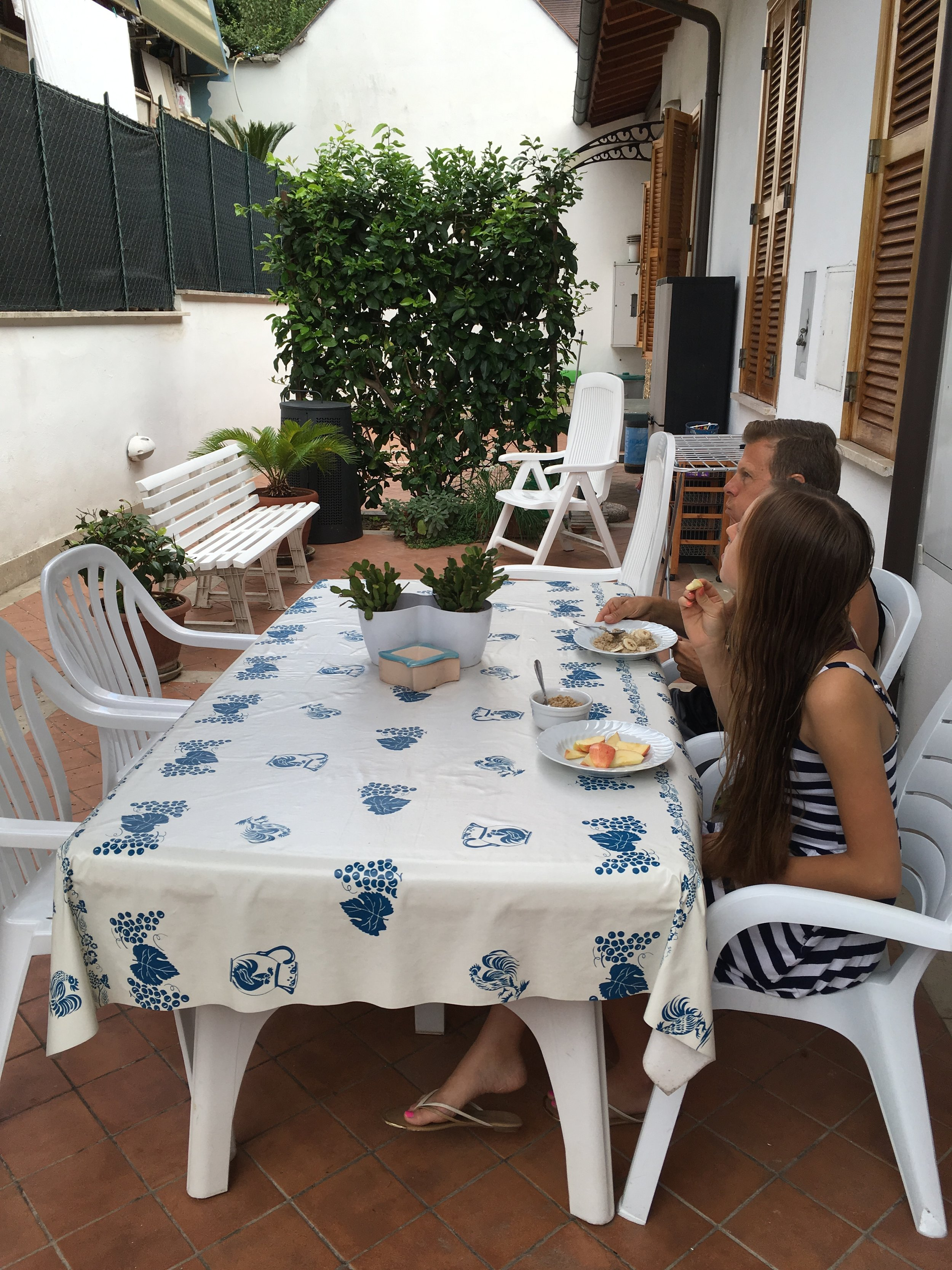 having breakfast in our cottage courtyard