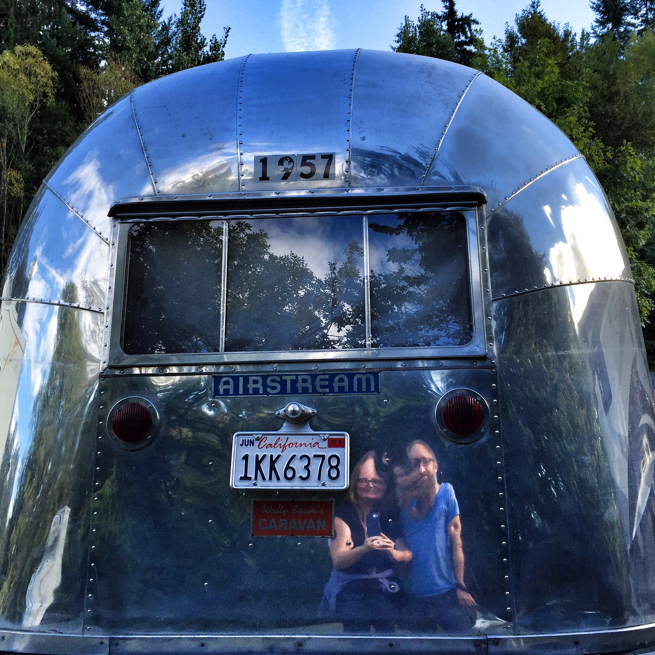 Fun house mirror reflection in vintage airstream
