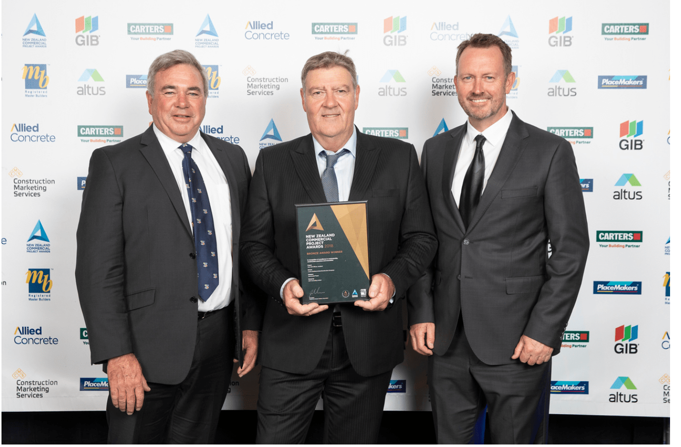 Left to right: Peter Alderton (Director), John Lawton and Nick Houlding (Director) accepting the 2018 NZ Commercial Project Award