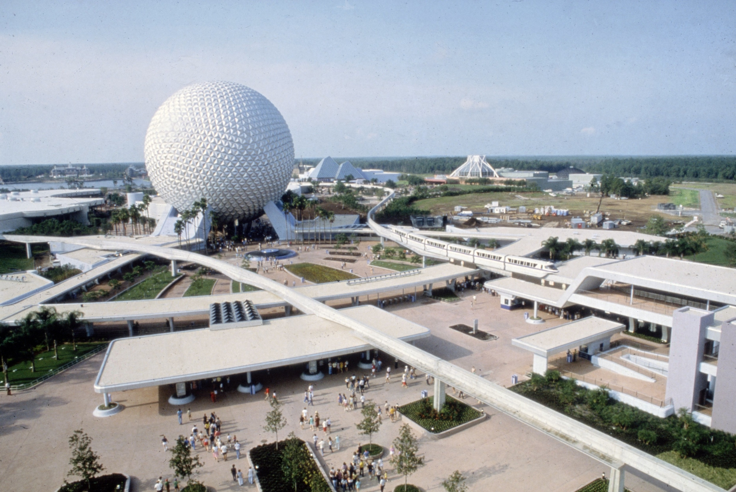 A view of the entrance to Epcot Center, curved lines, silver and white all over.