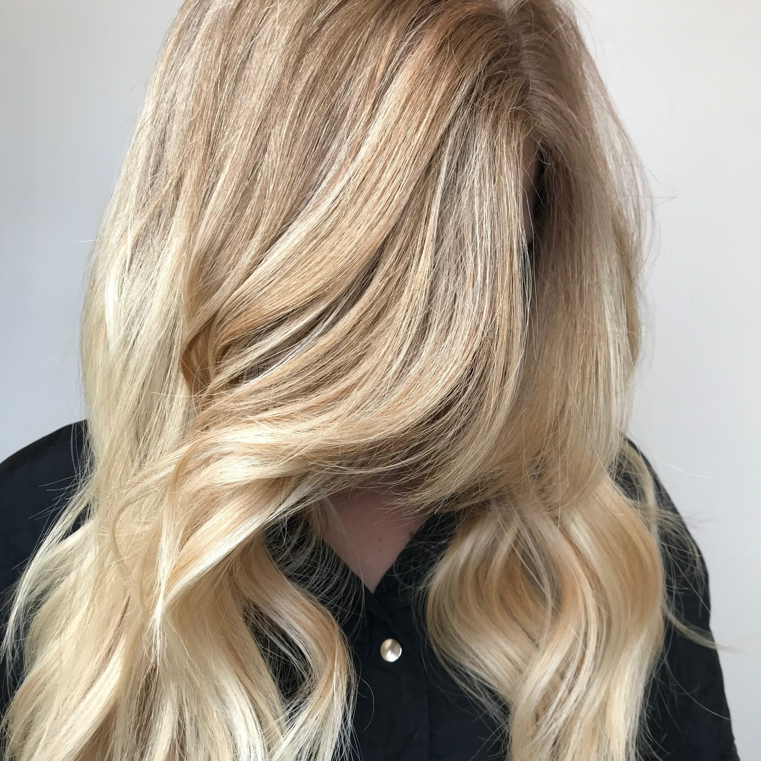 Bright Blonde - Are you in search of that perfect shade of blonde? A blonde full of dimension and many tones may be as close as it gets to that perfect blonde. Ask for heavier babylights that mixes many shades throughout your whole head and your stylist can achieve this look on you!