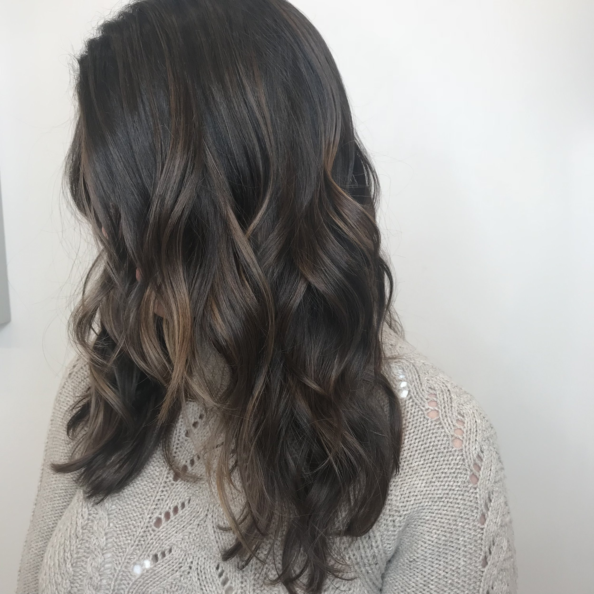 Glowy Highlights - Glowy highlights is to your hair as what a bomb highlighter is to your cheek bones. These lighter pieces strategically placed around your hairline will mimic your skin tone to in turn compliment your face and brighten the over all look of your hair.