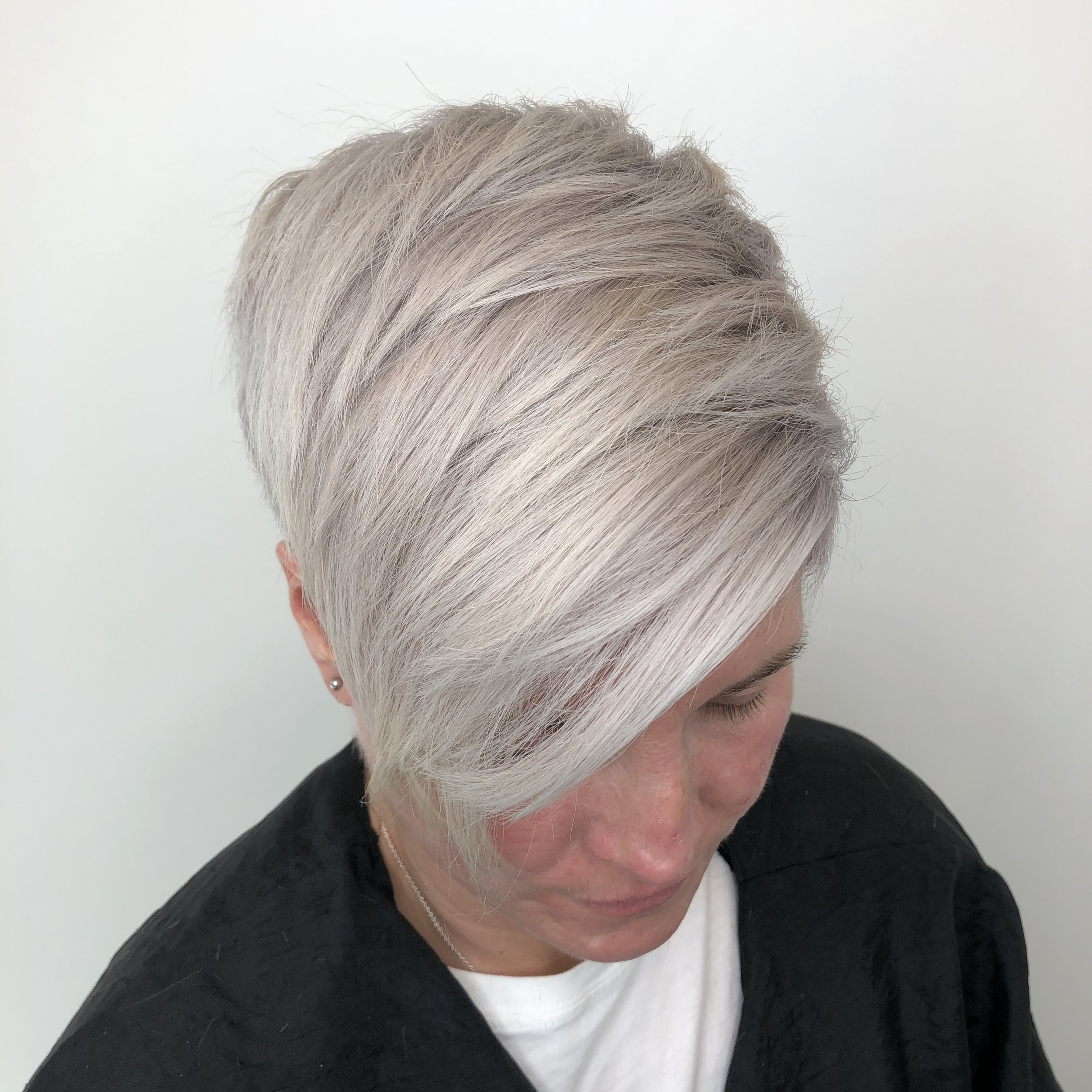 Pearly Blonde - Gone are the days of of flat one dimensional platinum blonde. Todays women are looking for a multifaceted color that show cases an effortless looking color. To get the pearly tone start with an almost white cool tone blonde and layer with a buttery blonde color to get this iridescent look.
