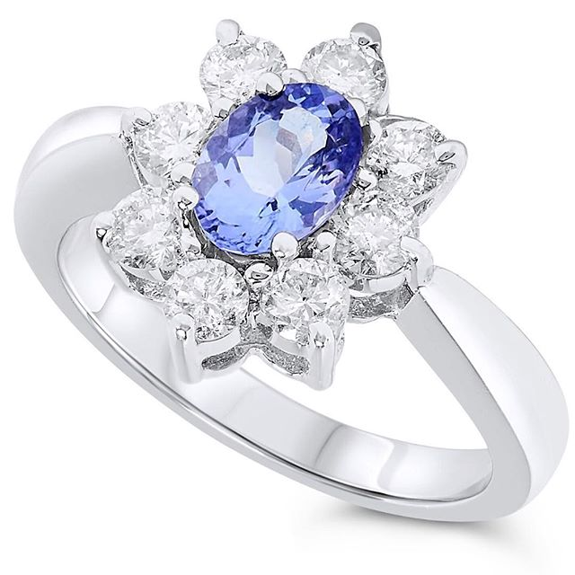 Tanzanite with a large diamond halo. #tanzanite #rings #luxury #jewelrypie