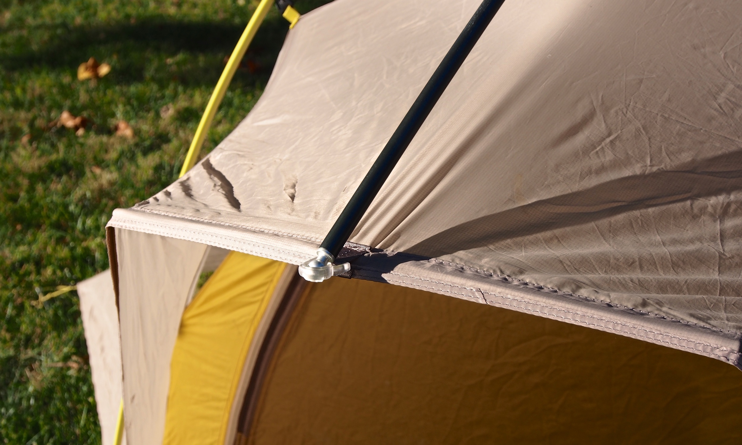 The Lightning 2 FL has a great awning feature that is created by this horizontal beam that is built into the tent fly.  To pack the tent down into a ball, you would have to remove these beam which is easily accomplished.
