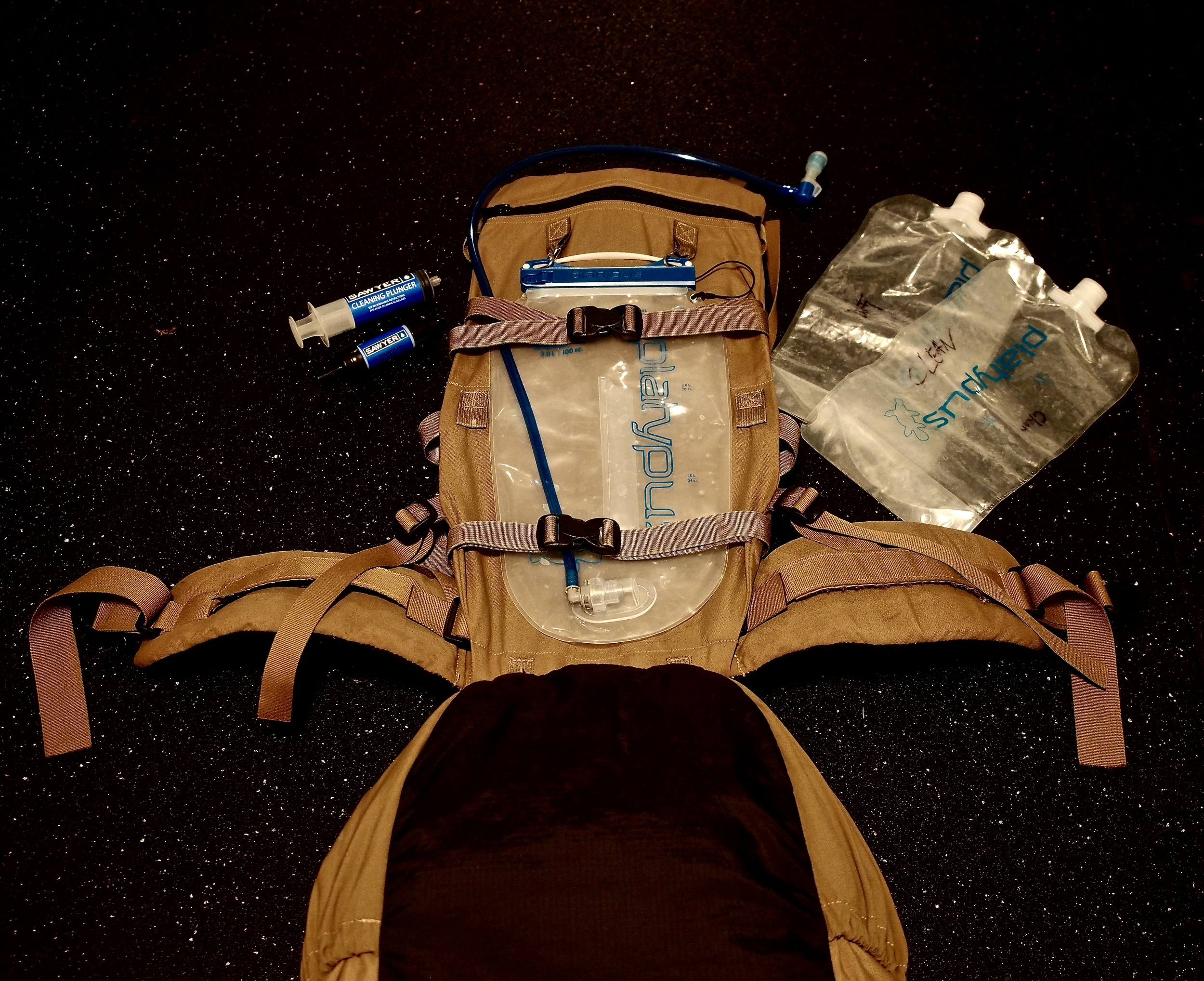 My water system consists of a 3 liter Platypus bladder, two 2 liter platypus bags, and a Sawyer Mini Water Filter. The pack you see here is the Exo Mountain Gear 3500.