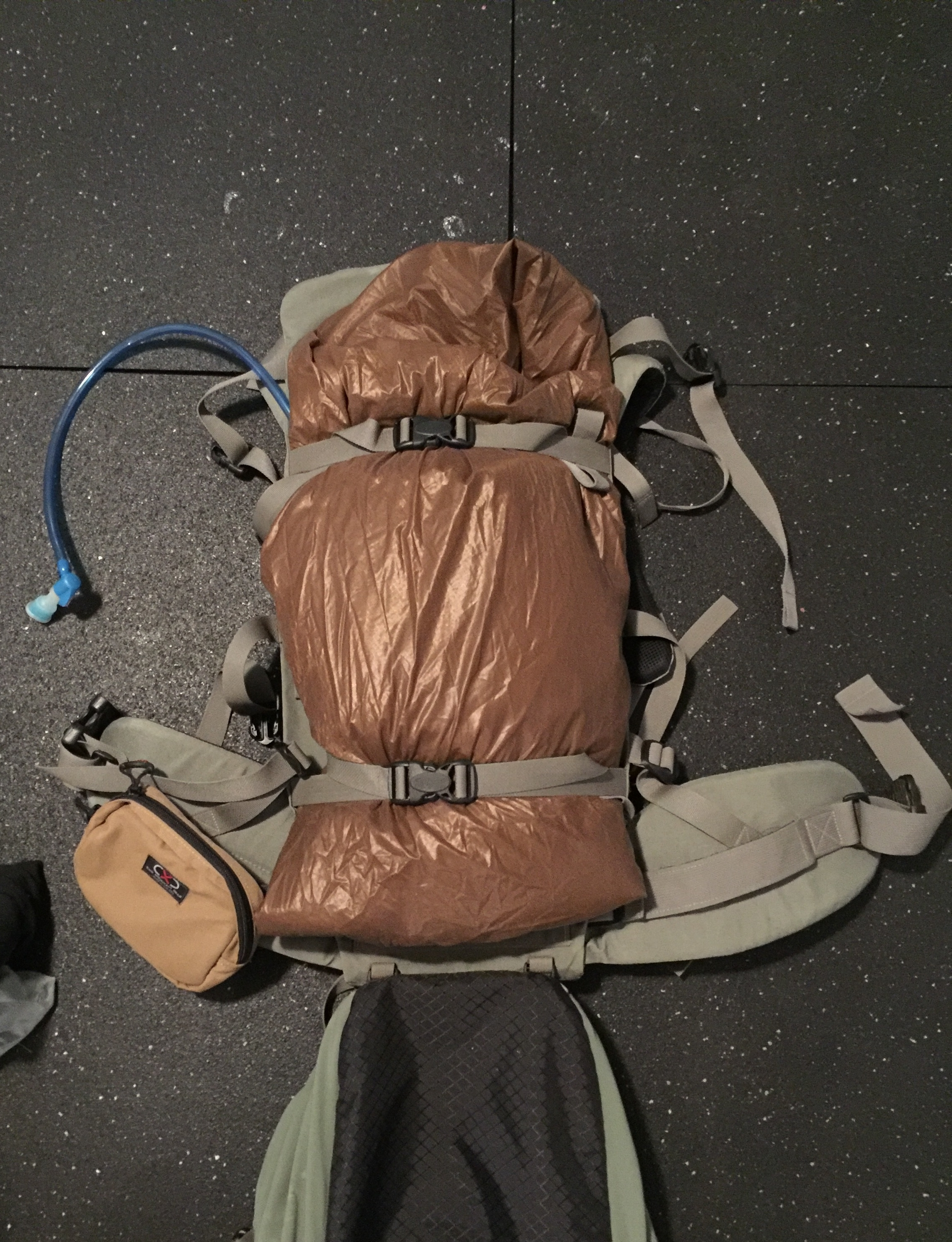 This is how I carry my tent. I fold it up and stash it on the load shelf of my backpack. I can save tons of room inside my pack doing it this way! Sorry for the Crocs creeping in the the shot...yeah..I wear Crocs in the backcountry...and around the house!