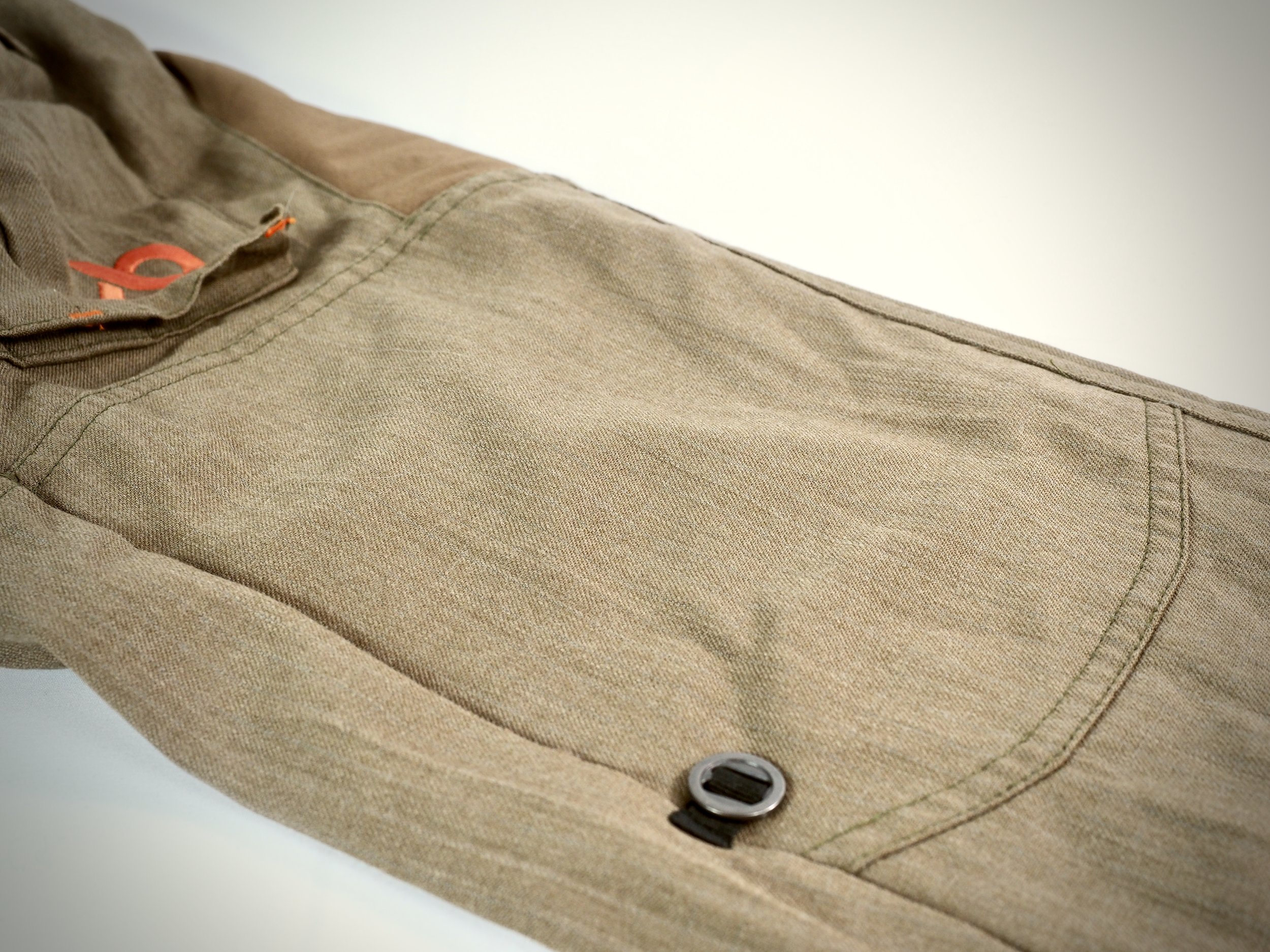 The button shown here is used to secure the pants when rolled up for crossing streams or cooling off. There is a tab on the inside it attaches to (see above photo).