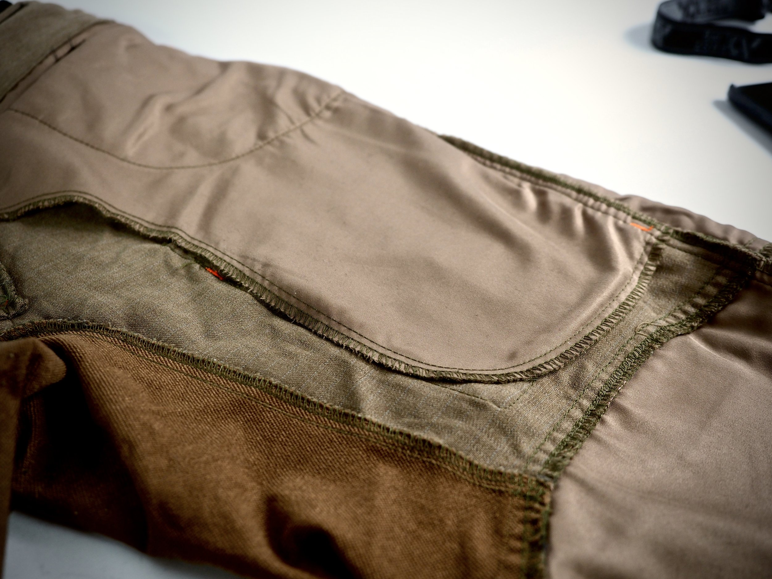 The front hand pockets are deep...and I mean DEEP. The bottoms of them reach all the way down to the bottom of the cargo pocket, which to me is a bit excessive.