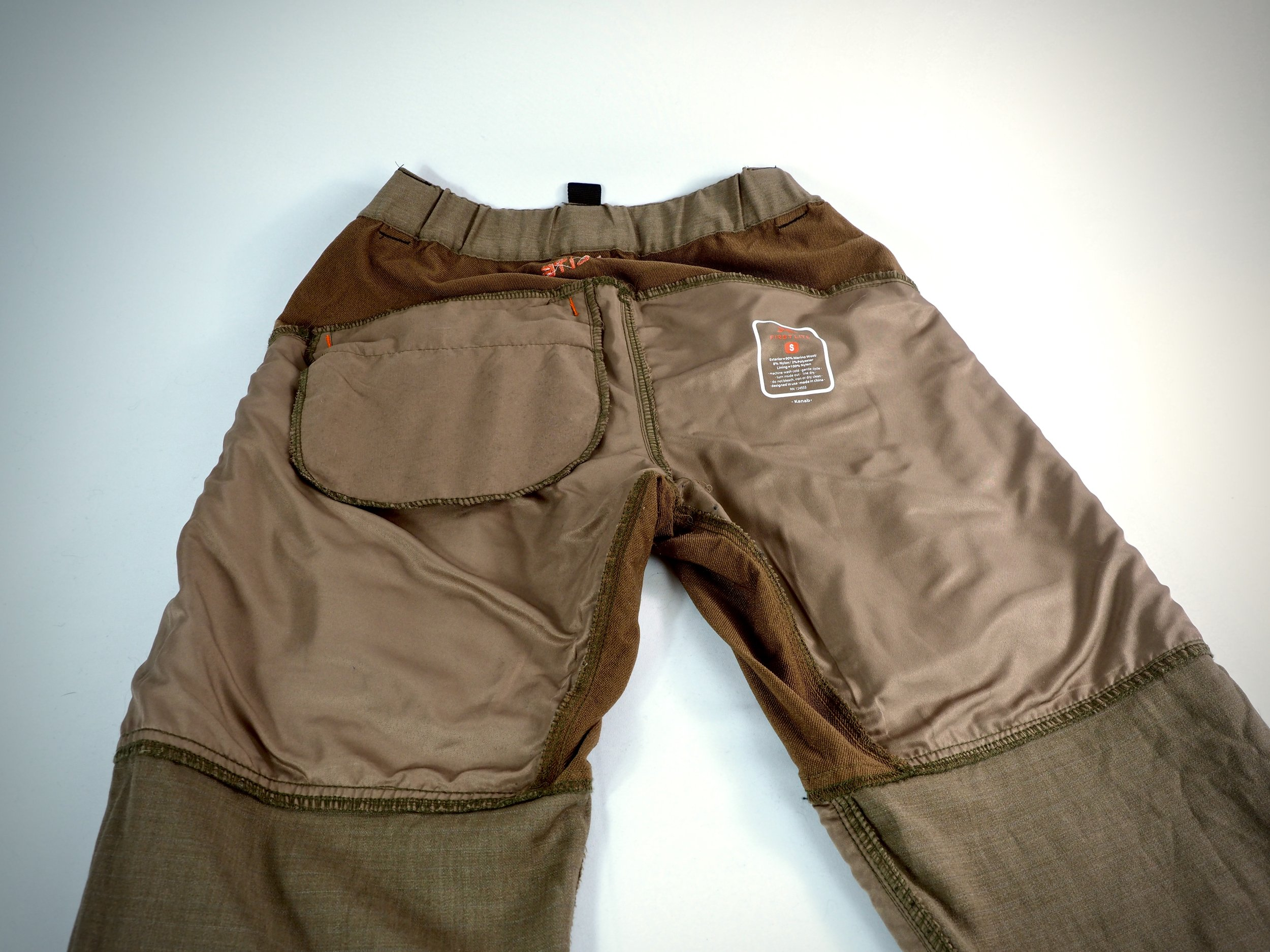 The inside of the pant is lined with some sort of nylon material. It's soft and comfortable against bare skin.